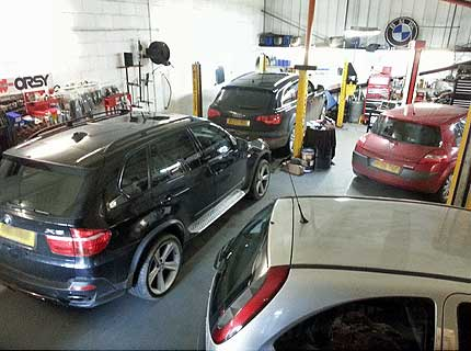 A BMW, Audi and a Toyota being repaired at Euromotors Sevenoaks